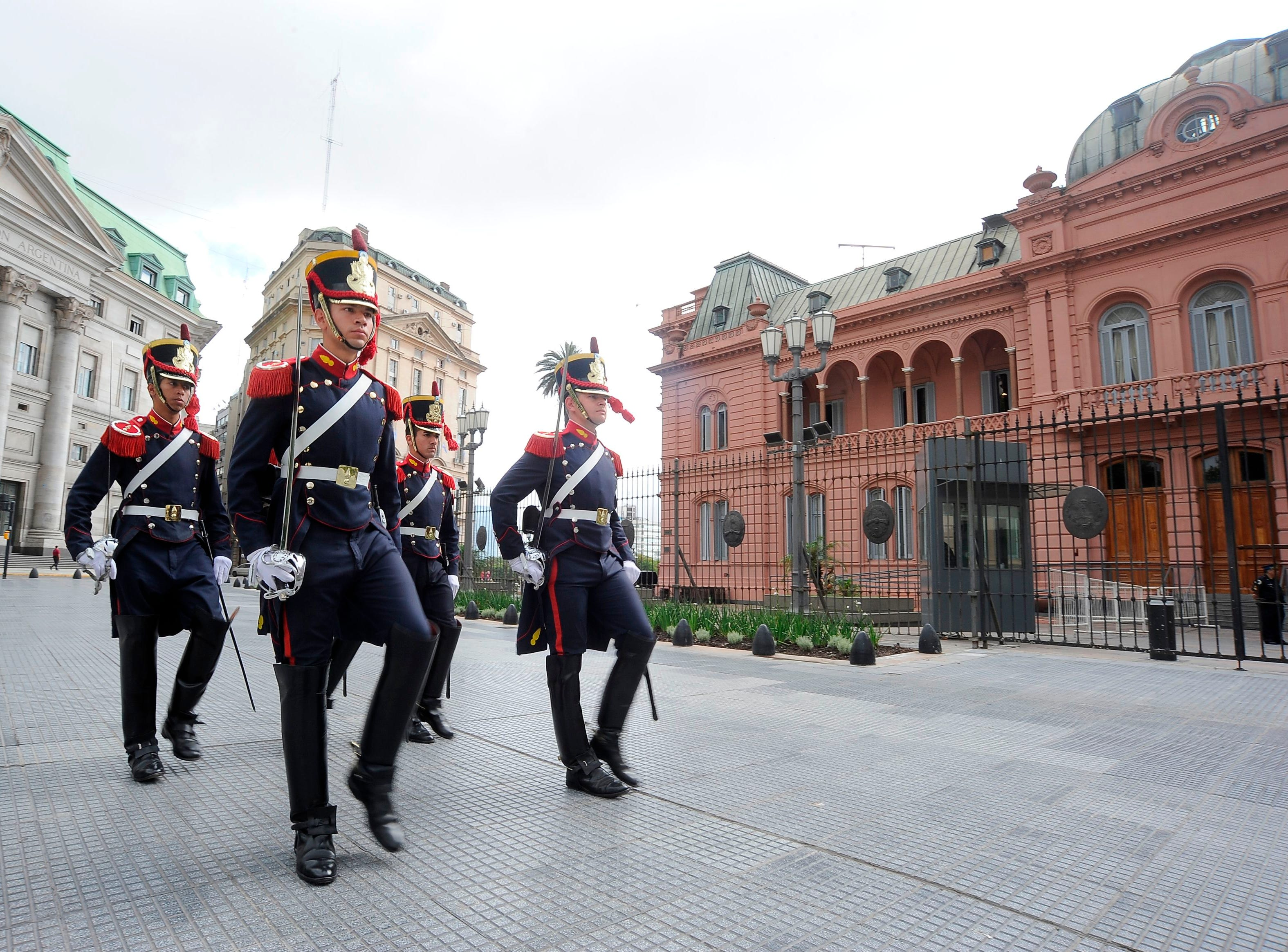 Soldiers from the elite Grenadier Regiment march outside of the Casa Rosada presidential palace in Buenos Aires on the eve of the G20 Leaders' Summit, on November 29, 2018. - Global leaders gather in the Argentine capital for a two-day G20 summit beginning on Friday likely to be dominated by simmering international tensions over trade. (Photo by JAVIER GONZALEZ TOLEDO / AFP)        (Photo credit should read JAVIER GONZALEZ TOLEDO/AFP/Getty Images)