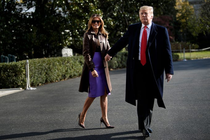 """US First Lady Melania Trump and US President Donald Trump walk to Marine One on the South Lawn of the White House November 29, 2018 in Washington, DC. - Trump said Thursday a weekend G20 summit of world leaders would be a """"very good time"""" for a meeting with Russian leader Vladimir Putin. (Photo by Brendan Smialowski / AFP)        (Photo credit should read BRENDAN SMIALOWSKI/AFP/Getty Images)"""