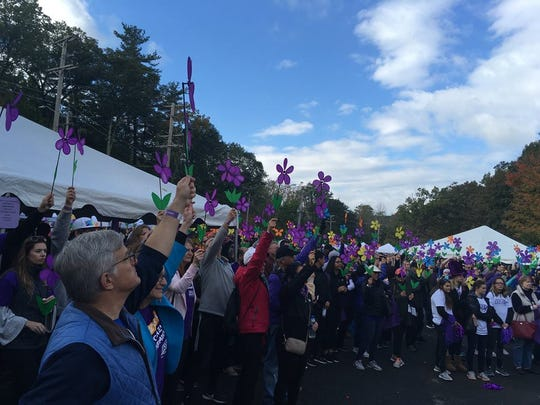 """Participants take part in the Oct. 20, 2018 opening ceremony of the Dutchess/UlsterWalk to End Alzheimer's on the Walkway Over the Hudson. The Alzheimer's Association is offering a free program, """"Legal and Financial Planning for Alzheimer's Disease,"""" Sept. 16 in Poughkeepsie."""