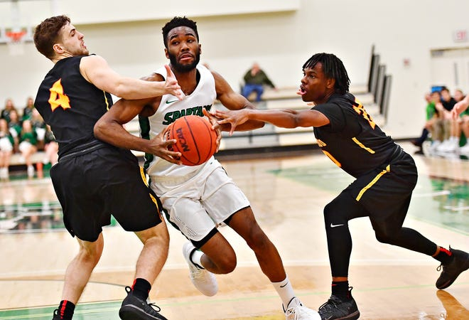 York College's Jason Bady, center, collected 19 points, nine rebounds, four assists, three steals and three blocks in a 68-57 win at Penn State Harrisburg on Wednesday night. YORK DISPATCH FILE PHOTO