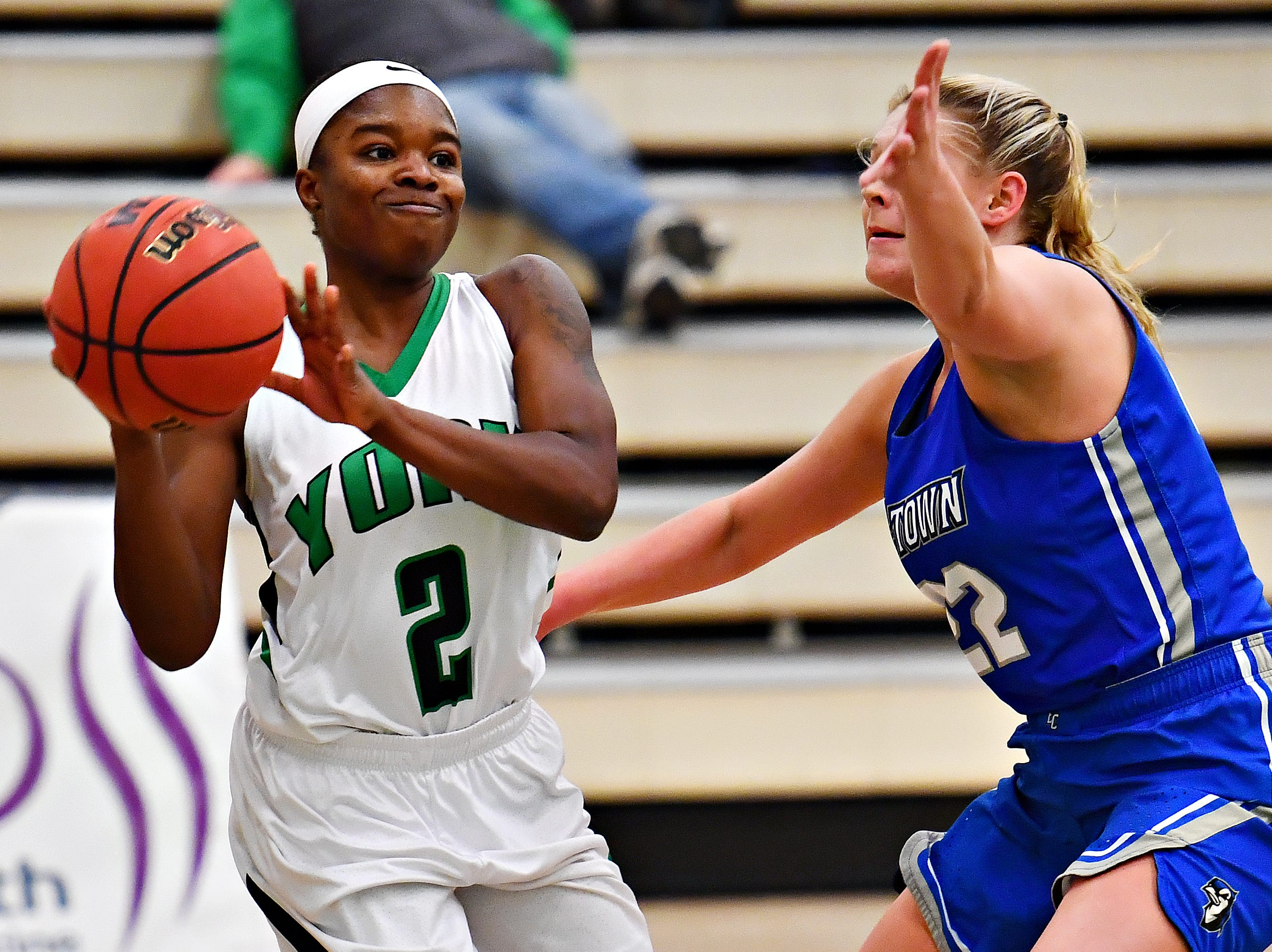 York College's Debria Hendricks, left, looks to get the ball past Elizabethtown's Lydia Lawson during women's basketball action at Grumbacher Sport and Fitness Center in Spring Garden Township, Wednesday, Nov. 28, 2018. Dawn J. Sagert photo
