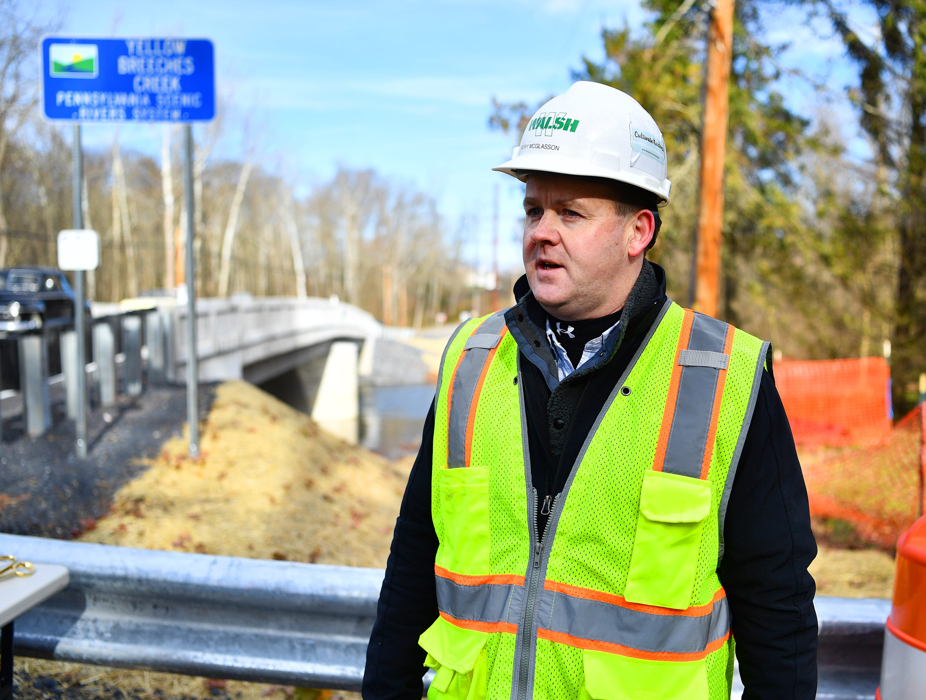 Public Information Coordinator Rory McGlasson, of Walsh Construction, speaks following ribbon-cutting ceremony commemorating the opening of the PA Rapid Bridge Replacement project's 500th bridge, located on Andersontown Road, spanning Yellow Breeches Creek into both Fairview and Lower Allen Townships, Thursday, Nov. 29, 2018. Dawn J. Sagert photo