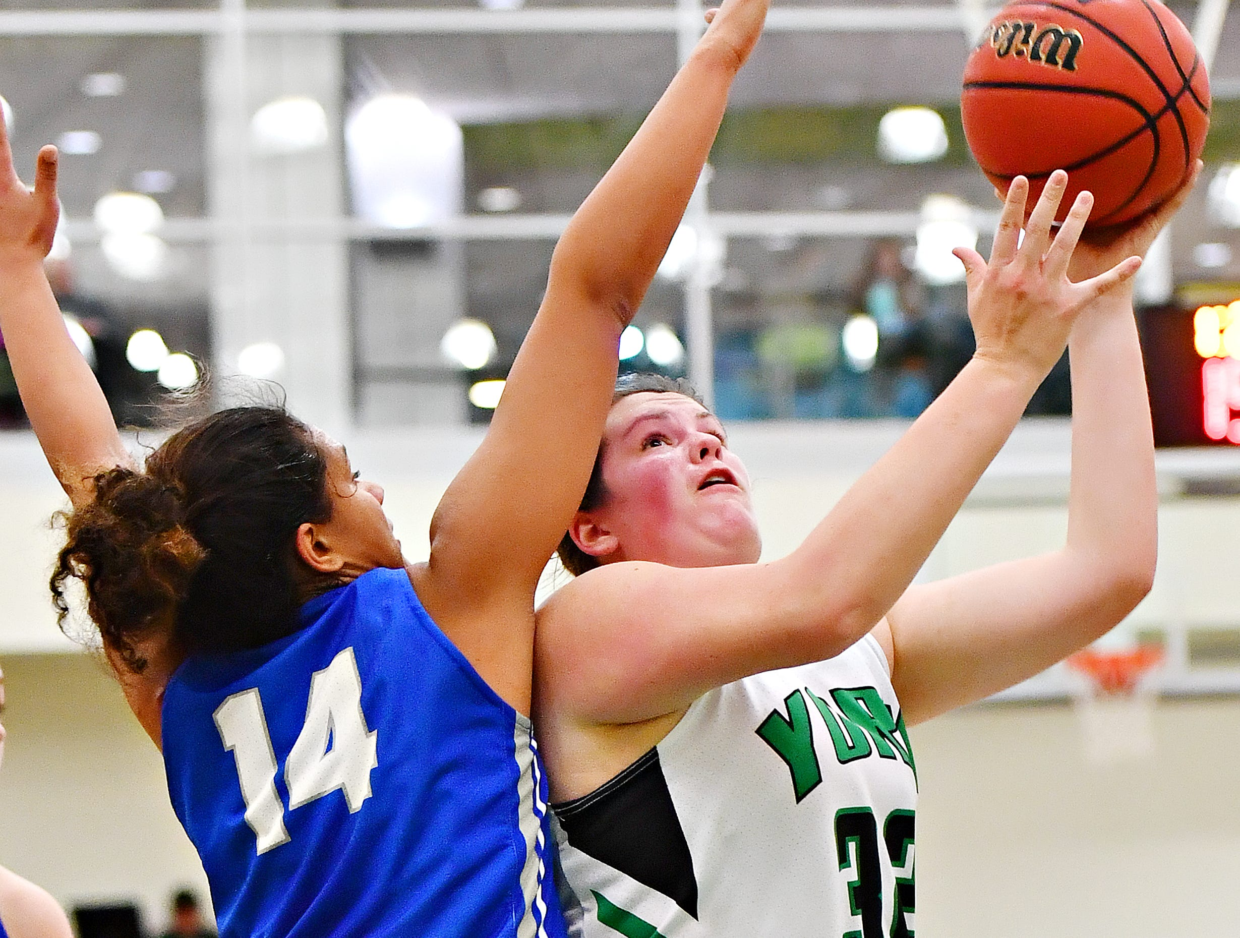 York College's Molly Day takes the ball to the net while Elizabethtown's Mikayla Ruth defends during women's basketball action at Grumbacher Sport and Fitness Center in Spring Garden Township, Wednesday, Nov. 28, 2018. Dawn J. Sagert photo
