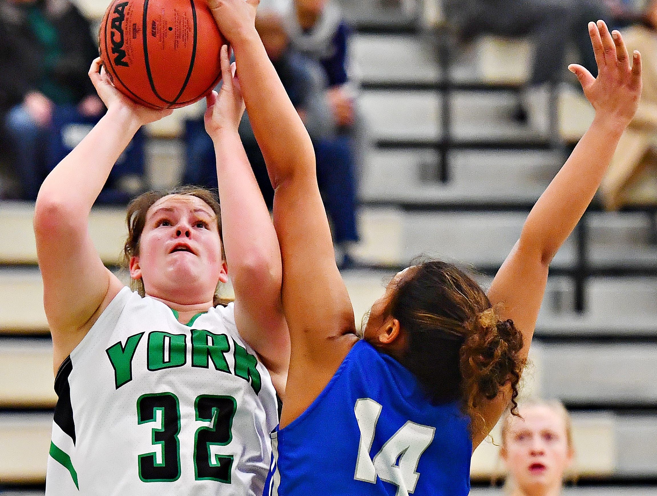 York College's Molly Day, left, gets stopped by Elizabethtown's Mikayla Ruth during women's basketball action at Grumbacher Sport and Fitness Center in Spring Garden Township, Wednesday, Nov. 28, 2018. Dawn J. Sagert photo