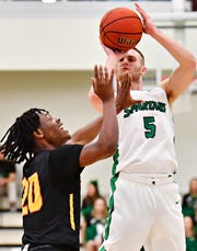 York College's Jared Wagner, right, lines up his shot while Gwynedd-Mercy's Clayton Wolfe defends during men's basketball action at the Grumbacher Sport and Fitness Center in Spring Garden Township, Wednesday, Nov. 28, 2018. Wagner is averaging 15.6 points per game for the Spartans this season. Dawn J. Sagert photo