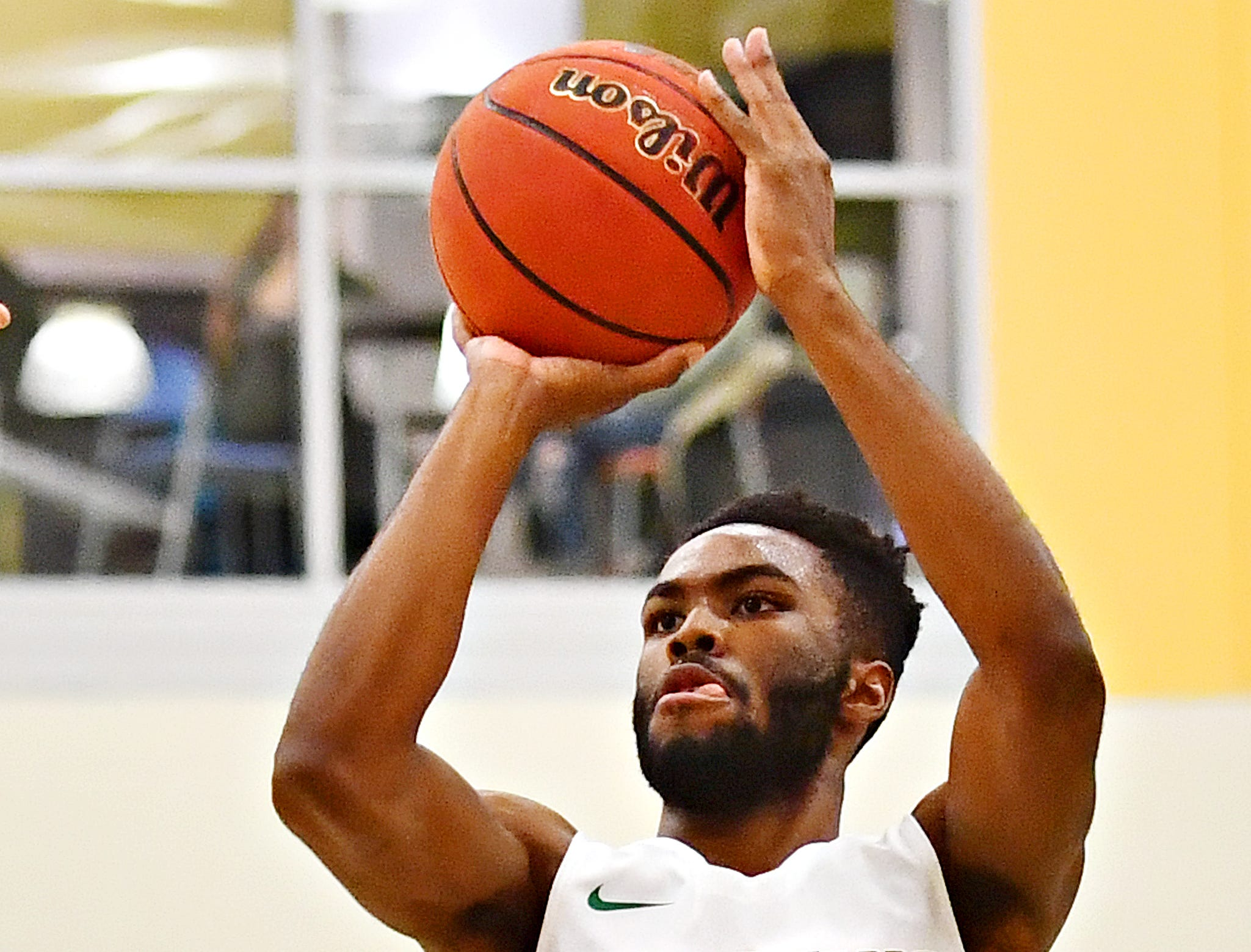 York College's Jason Bady aims for the basket during men's basketball action against Gwynedd-Mercy at Grumbacher Sport and Fitness Center in Spring Garden Township, Wednesday, Nov. 28, 2018. Dawn J. Sagert photo