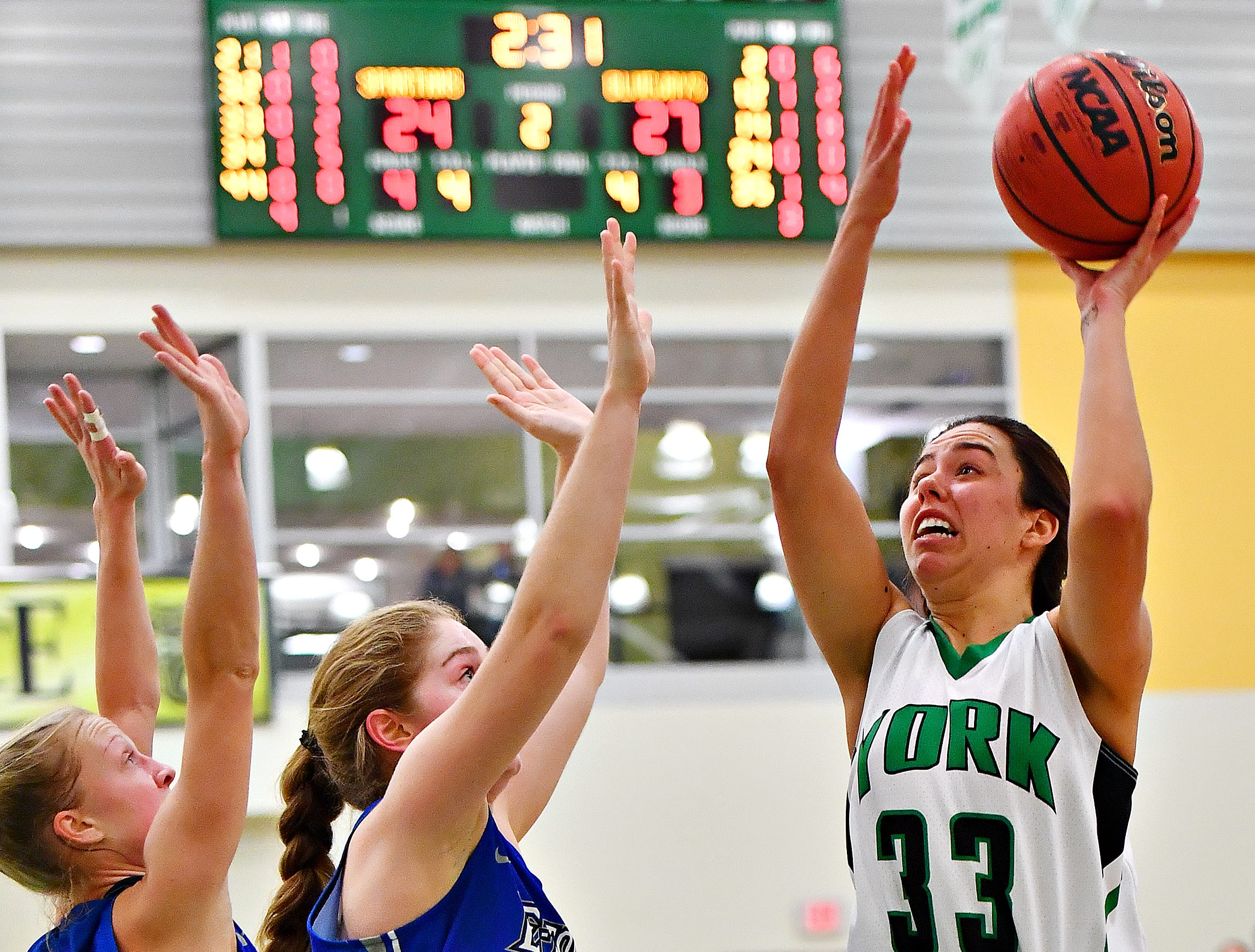 York College's Meghan Carlson, right, aims for the net while Elizabethtown's Lydia Lawson, left, and Emma Powell defend during women's basketball action at Grumbacher Sport and Fitness Center in Spring Garden Township, Wednesday, Nov. 28, 2018. Dawn J. Sagert photo