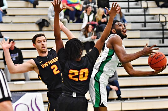 York College senior Jason Bady, right, scored in double digits in both the Spartans' NCAA D-III Tournament games. DISPATCH FILE PHOTO