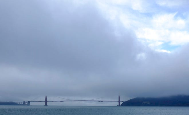 A break in the weather appears over the Golden Gate Bridge Wednesday, Nov. 28, 2018, in San Francisco. Forecasters say California will see widespread rain and heavy Sierra snowfall starting late Wednesday that could create travel problems and unleash damaging runoff from wildfire burn scars.