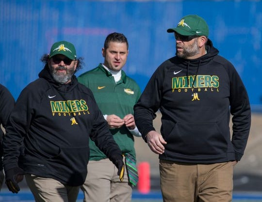 Ernie Howren  (right) with the Bishop Manogue assistant coaches Pete Burgarello (left) and Tony Burgarello (center)  last Saturday at the state semifinal football game at McQueen.