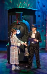 Conductor Ashlyn Orton suggests to Lauren Joyner that she should board the train.
