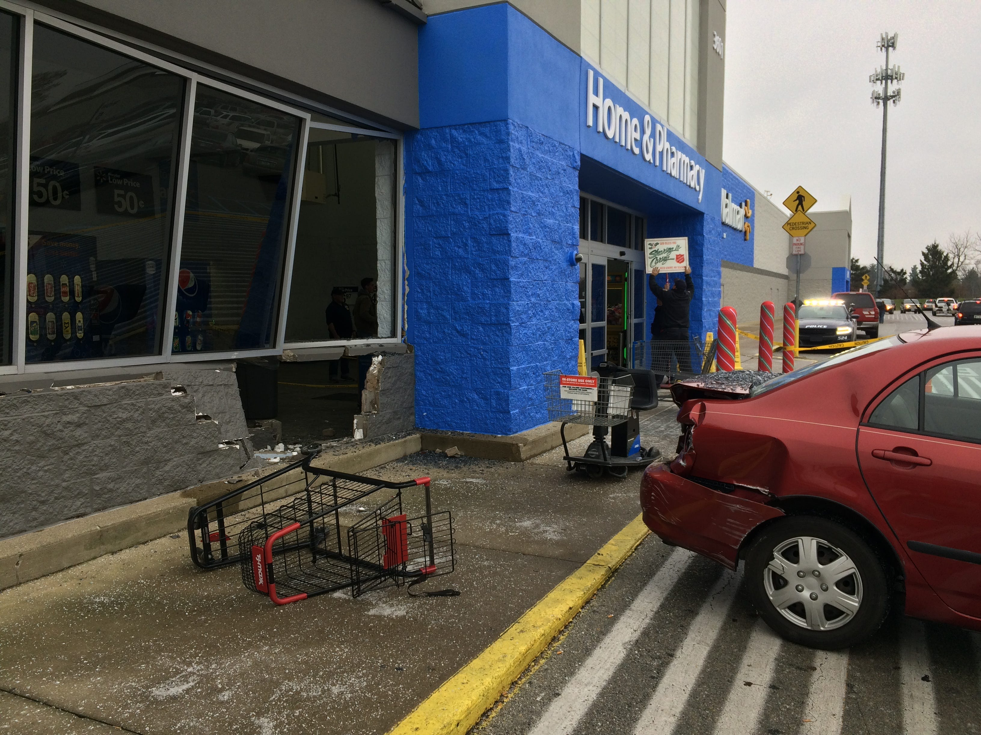 A driver damaged Walmart near the east entrance Thursday, leaving a hole in a block wall.