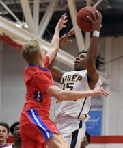 University Prep's Jakhi Lucas, right, is defended by Fairport's Jack Lindstrom during a game played at Roberts Wesleyan College earlier this season. Fairport beat University Prep 56-51.