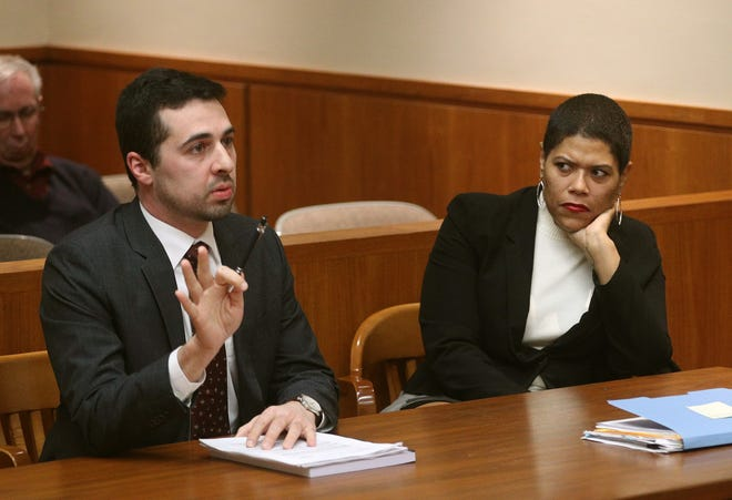 Leticia Astacio in court with her attorney Mark Foti for an earlier hearing on charges that she attempted to illegally purchase a shotgun.