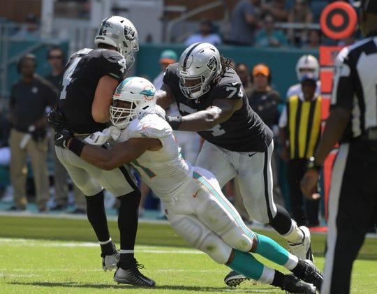 Miami Dolphins defensive end Cameron Wake sacks Oakland Raiders quarterback Derek Carr.