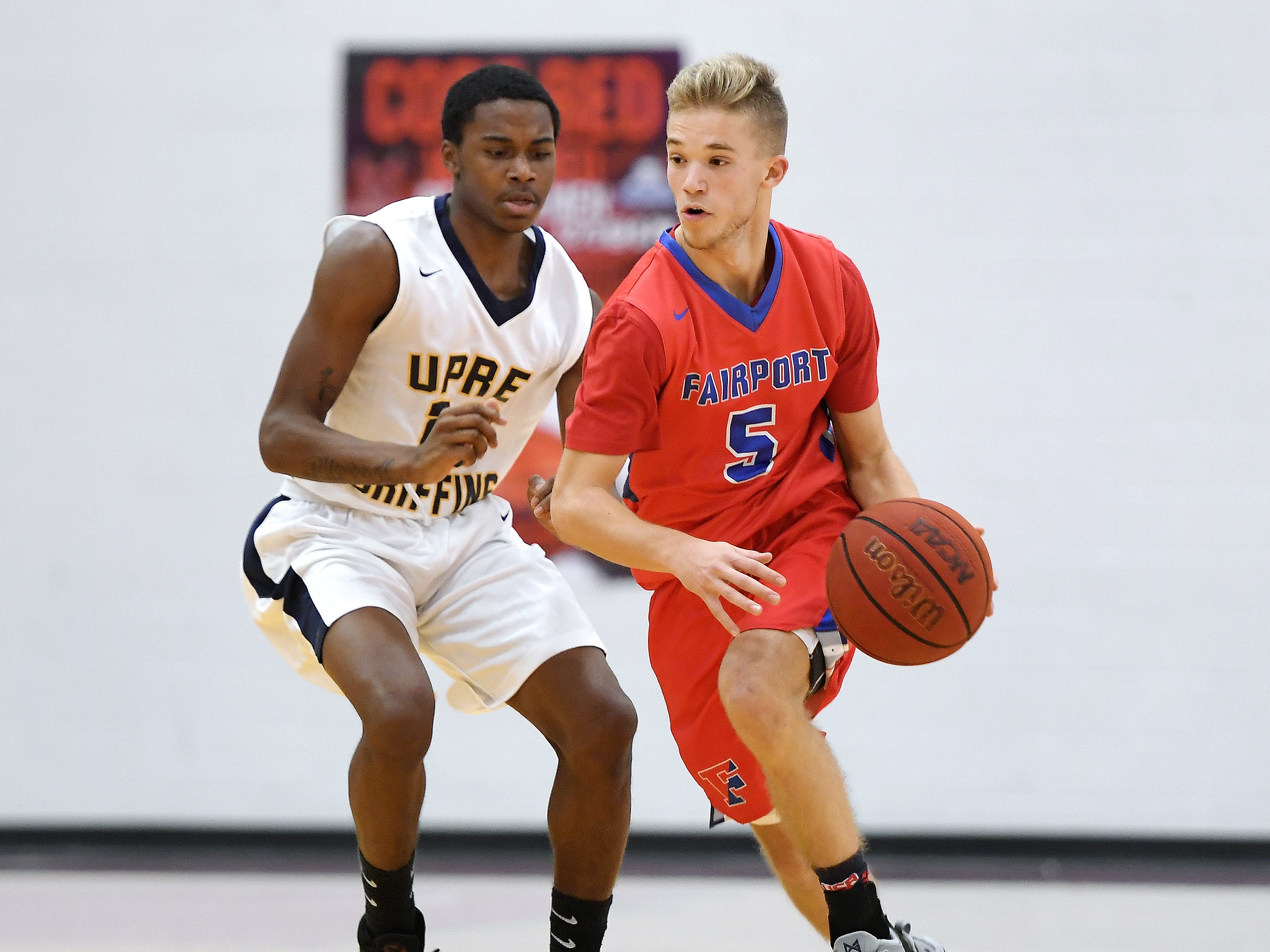 Fairport's Ryan Kennedy, right, dribbles past University Prep's Harold Boggs McCulough during a regular season game played at Roberts Wesleyan College on Wednesday, Nov. 28, 2018. Fairport beat University Prep 56-51.