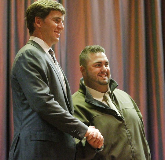 In May 2012, John Nucci, a lifelong New York Giants fan, met quarterback Eli Manning at the 63rd Rochester Press-Radio Club dinner.