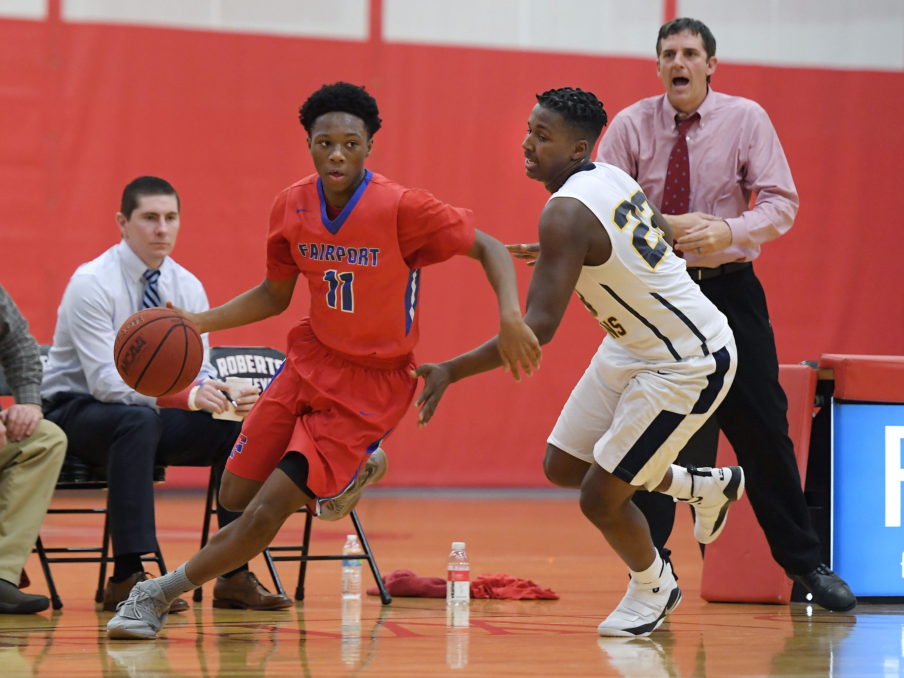 Fairport's Vanzell Johnson, left, drives by University Prep's Kendrick Cheyshad during a regular season game played at Roberts Wesleyan College on Wednesday, Nov. 28, 2018. Fairport beat University Prep 56-51.