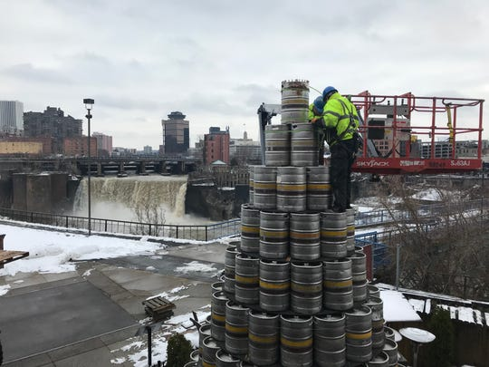 The final of the 520 half-barrel kegs is secured atop the Genesee Brewery keg tree Thursday, Nov. 29, 2018. This year's tree is 27 feet tall.