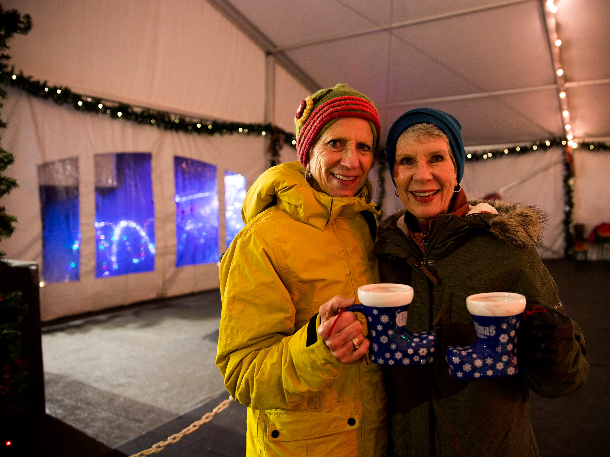 Barbara Luscher (left) shows her sister Marsha Fairbrook (right) around  Christmas in the Garden at the Oregon Garden Resort on Wednesday, Nov. 28, 2018, in Silverton. The winter wonderland, which features one million lights, is on display through Dec. 31.