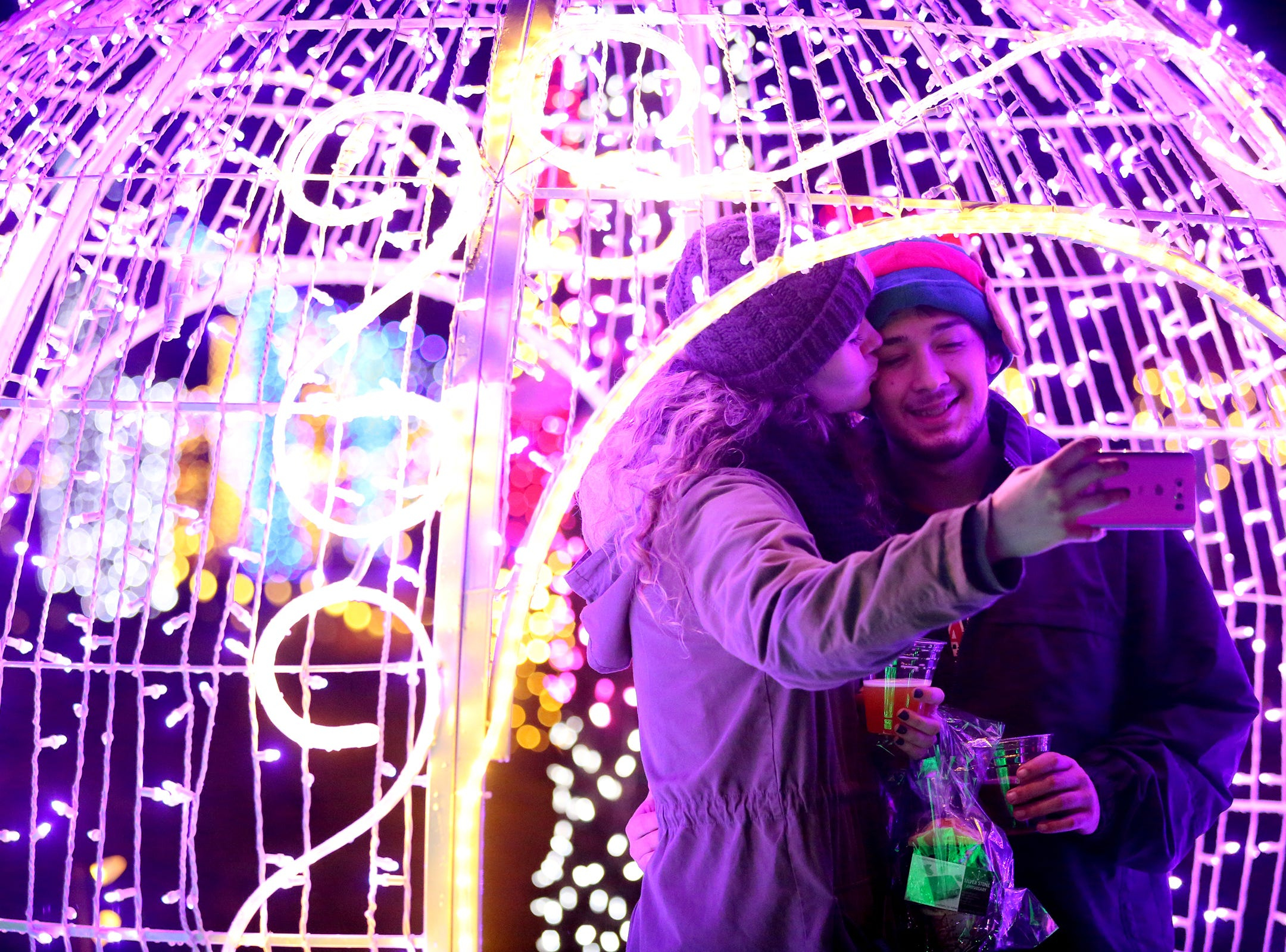 Mackenzie Gray and her boyfriend Michael Guerrero take a selfie during Christmas in the Garden at the Oregon Garden Resort on Wednesday, Nov. 28, 2018, in Silverton. The winter wonderland, which features one million lights, is on display through Dec. 31.