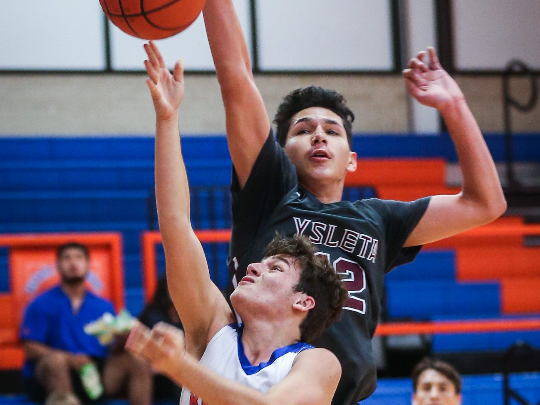 Central's Jaison Duarte attempts to shoot the ball as Ysleta blocks during the Doug McCutchen Basketball Tournament Thursday, Nov. 29, 2018, at Central High School.