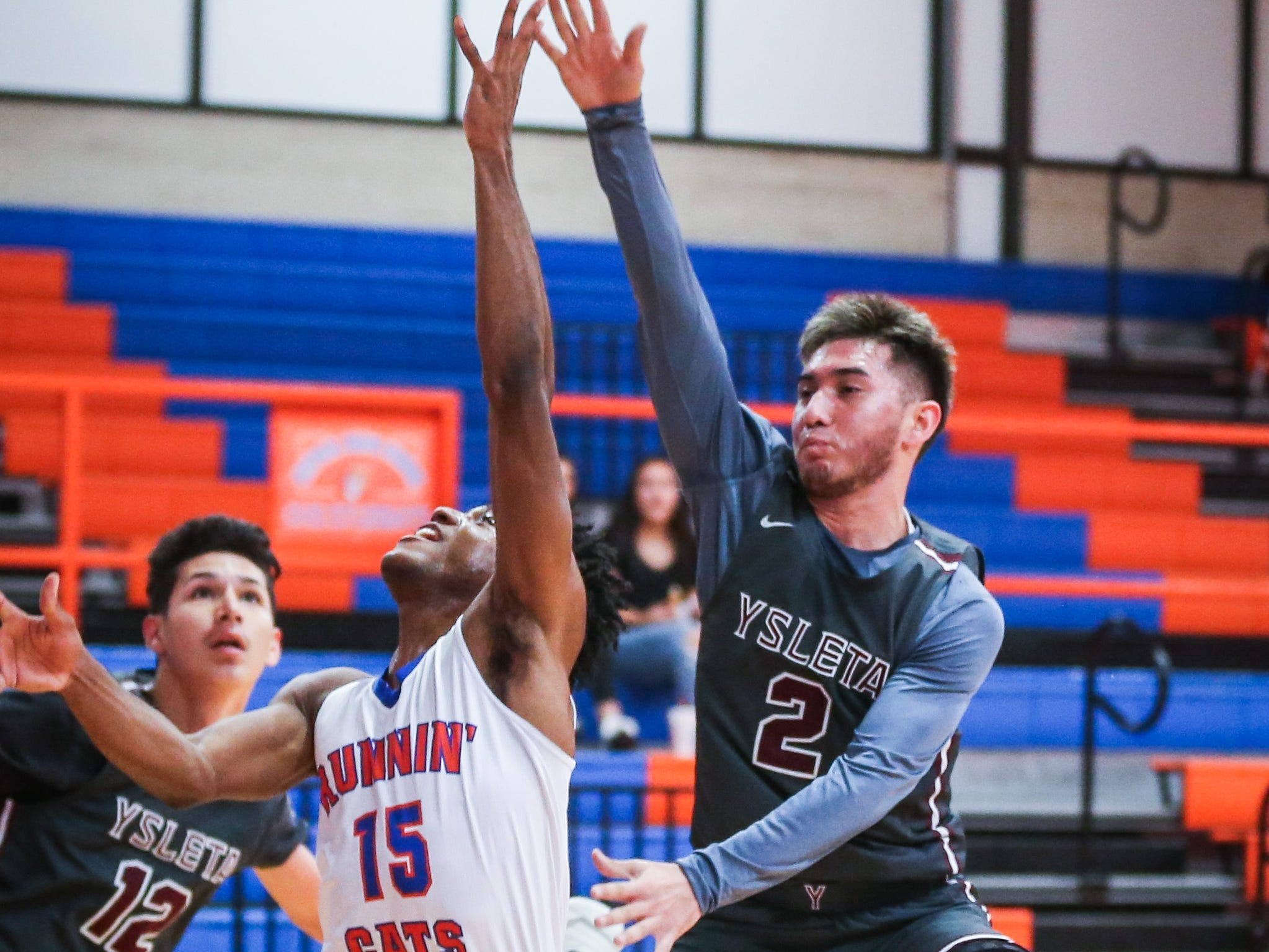Central's Michael Bonner attempts to shoot the ball as Ysleta blocks during the Doug McCutchen Basketball Tournament Thursday, Nov. 29, 2018, at Central High School.