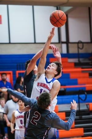 Central's Tristan Lopez attempts to shoot the ball as Ysleta blocks during the Doug McCutchen Basketball Tournament Thursday, Nov. 29, 2018, at Central High School.