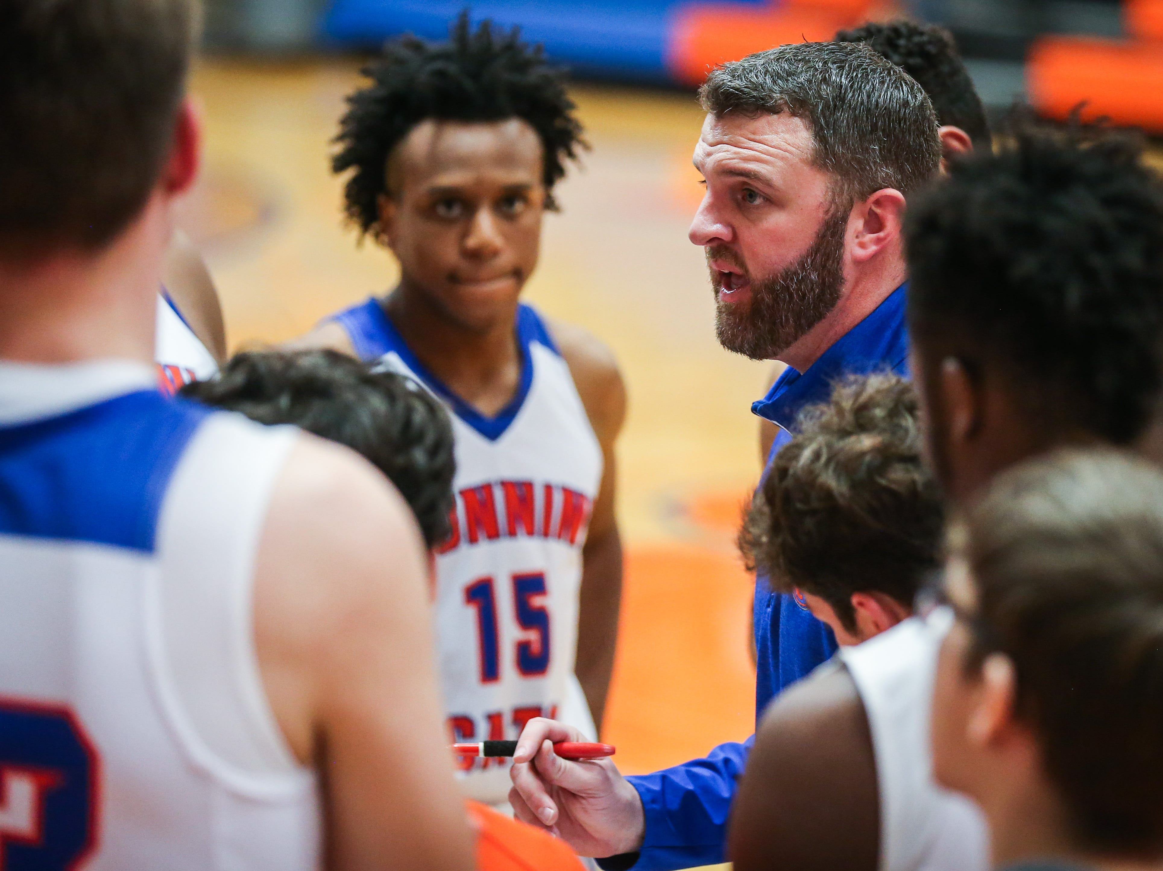 Central coach talks to the team during the Doug McCutchen Basketball Tournament Thursday, Nov. 29, 2018, at Central High School.