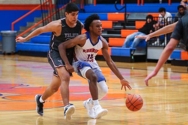 Central's Michael Bonner dribbles as Ysleta blocks during the Doug McCutchen Basketball Tournament Thursday, Nov. 29, 2018, at Central High School.