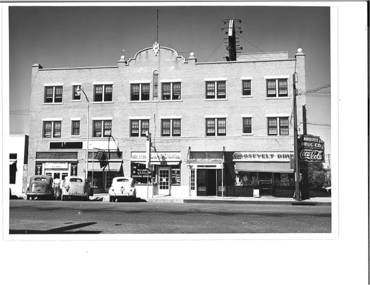 This file photo from the 1940s shows the Roosevelt Hotel and several businesses. The hotel closed in 1995.