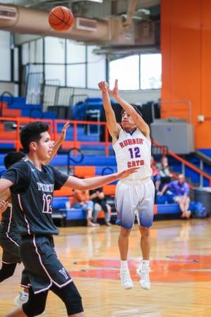 Central's Tristan Lopez jumps to shoot against Ysleta during the Doug McCutchen Basketball Tournament Thursday, Nov. 29, 2018, at Central High School.