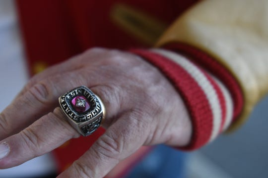 Bob Luckett, A member of the original T.C. Williams Titans football team that was featured in the Remember the Titans movie. Wears his high school AAA State football championship team ring.