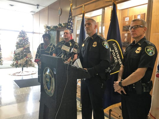 Substitute Chief Benjamin Raymond, second from right, answers questions during a press conference at the Shreveport Police Department Nov. 29.