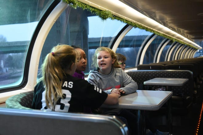 Children sit in the BNSF train in Sioux Falls, S.D., Thursday, Nov. 29, 2018.