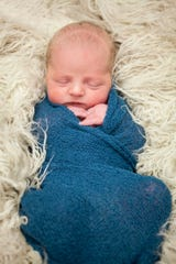 Deckard James Leveille, 7 lbs 3 oz, was born at 8:37 a.m. Nov. 24 in his family's backyard in Parker, South Dakota.
