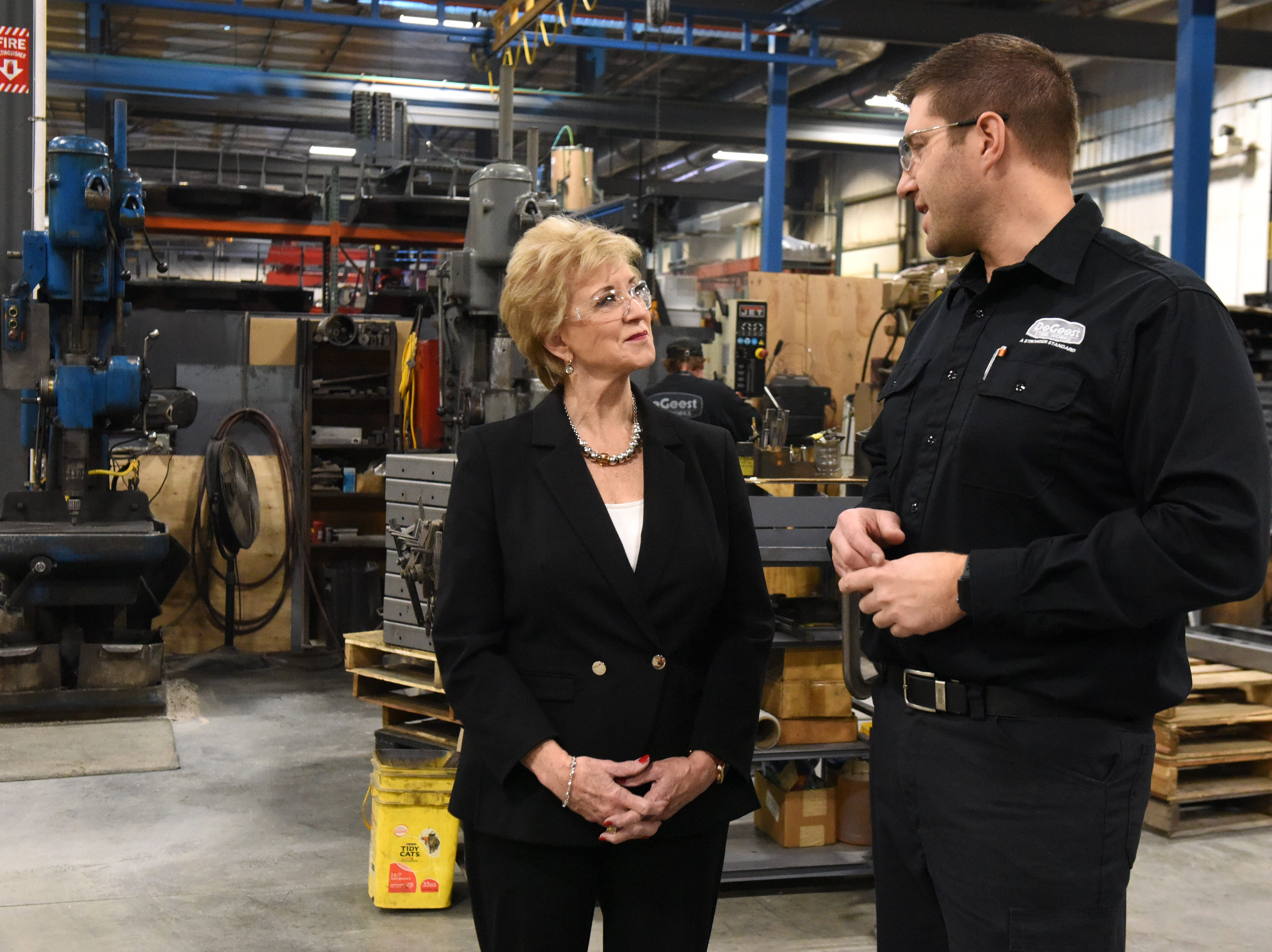 Linda McMahon, head of the U.S. Small Business Administration, gets a tour from Derek DeGeest at DeGeest Steel Works in Tea, S.D., Thursday, Nov. 29, 2018.