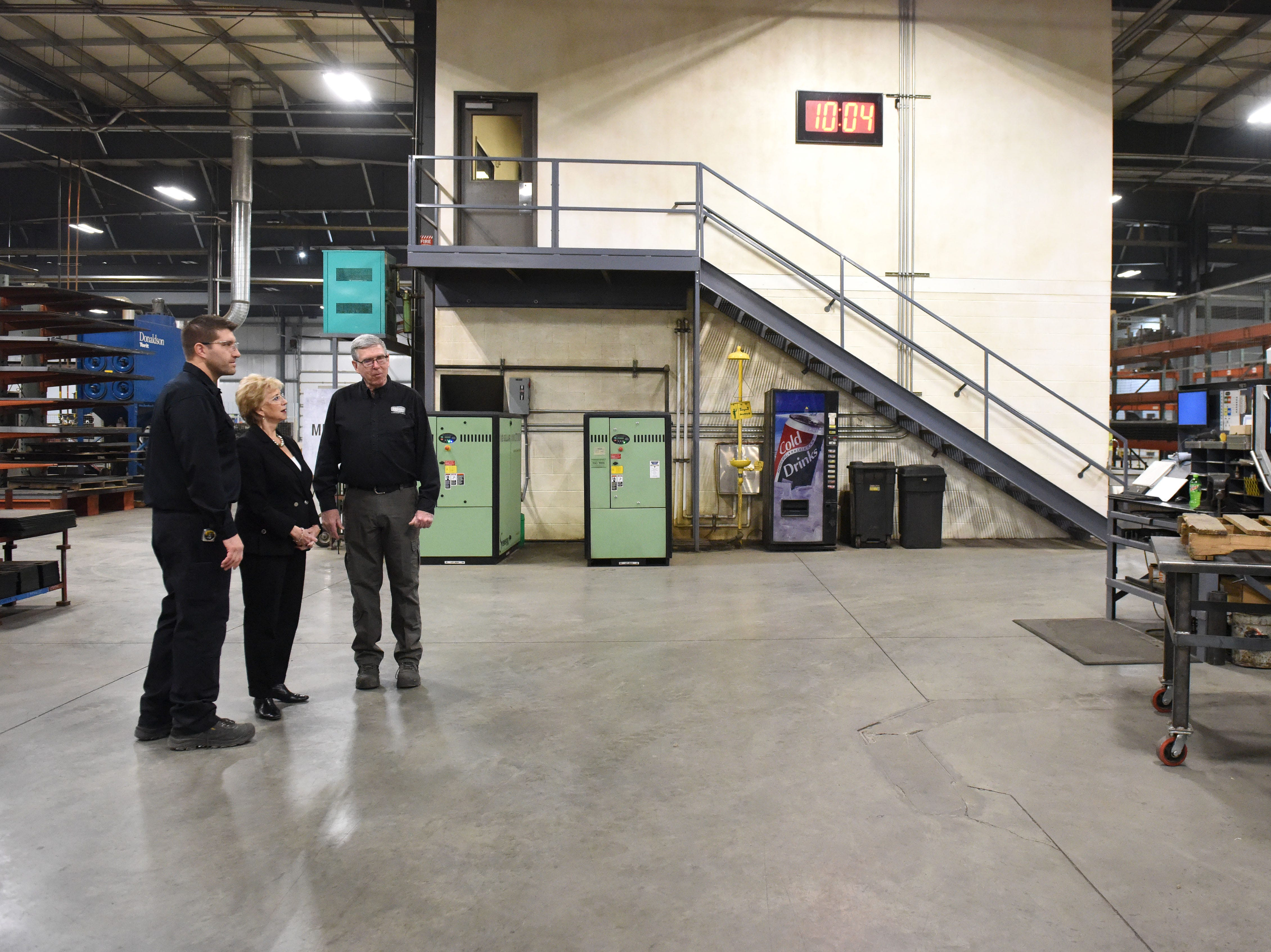 Linda McMahon, head of the U.S. Small Business Administration, gets a tour from Scott and Derek DeGeest at DeGeest Steel Works in Tea, S.D., Thursday, Nov. 29, 2018.