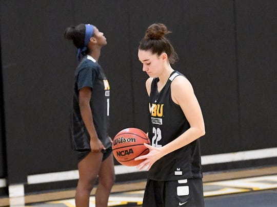 Mary Baldwin freshman Leah Calhoun stands at the line and prepares to shoot while practices her free-throw shooting during team practice at the university in Staunton on Wednesday night, Nov. 28, 2018.