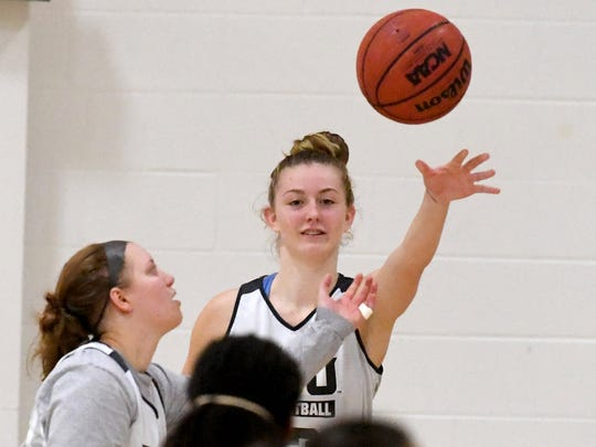 Mary Baldwin freshman Hannah Varner passes the ball to a teammate during team practice at the university in Staunton on Wednesday night, Nov. 28, 2018.