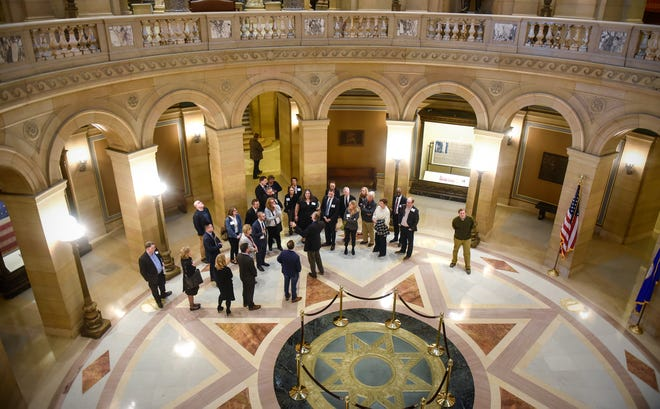 In this November 2018 file photo, newly elected state lawmakers are given a tour of the state Capitol in St. Paul.