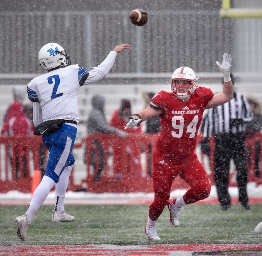 Defensive end Ted Kalina concentrates on the ball during the first half of the Saturday, Nov. 10, game against Thomas Moore University at Clemens Stadium in Collegeville.