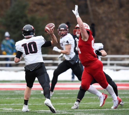 Defensive end Ted Kalina of St. John's reaches up to block a pass  during the Saturday, Nov. 24, game against Whitworth at Clemens Stadium in Collegeville.