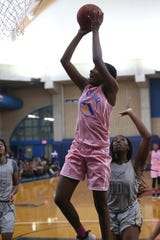 Tallahassee Community College guard Juliunn Redmond shoots from inside the paint against Andrew College.