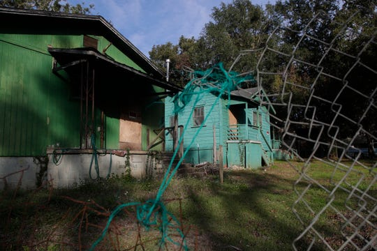 Abandoned houses sit boarded up on Floral Street in Tallahassee's Bond Neighborhood Thursday, Nov. 29, 2018.