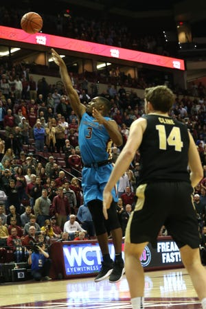 Florida State Seminoles guard Trent Forrest (3) shoots the game winning shot for the Florida State Seminoles to beat the Purdue Boilermakers by one point at the Tucker Civic Center, Wednesday, Nov. 28, 2018.