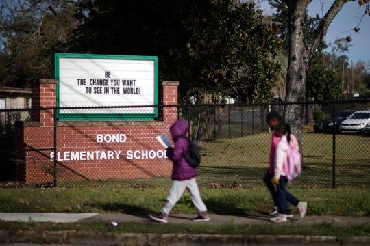 Bond Elementary School students walk home after their 2:50 p.m. dismissal Thursday, Nov. 29, 2018.