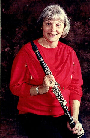 Clarinetist Ginny Densmore was called upon to organize this year's Holiday Tour of Homes, which will take place on Friday and Saturday.