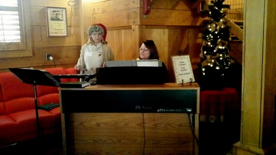 Gina Synder and sister Gayle Grisset perform at a previous holiday Tour of Homes.