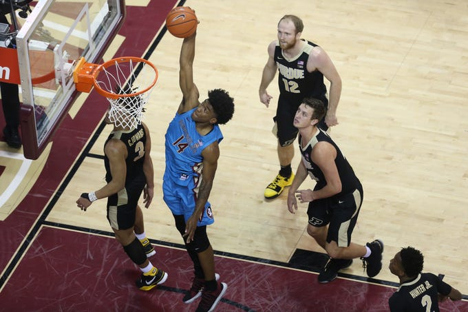 Florida State Seminoles guard Terance Mann (14) dunks on the Purdue Boilermakers as the Florida State Seminoles host the Purdue Boilermakers at the Tucker Civic Center, Wednesday, Nov. 28, 2018.